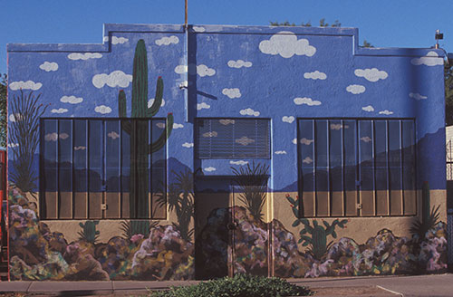 cactus themed mural on building