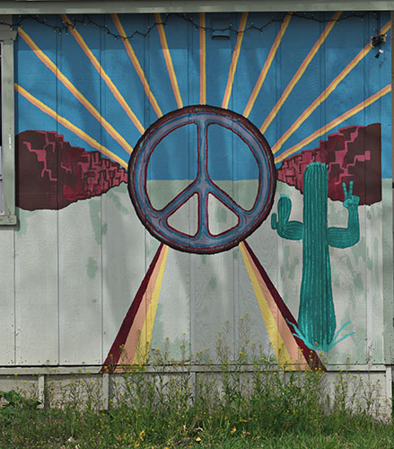 cactus and peace sign mural